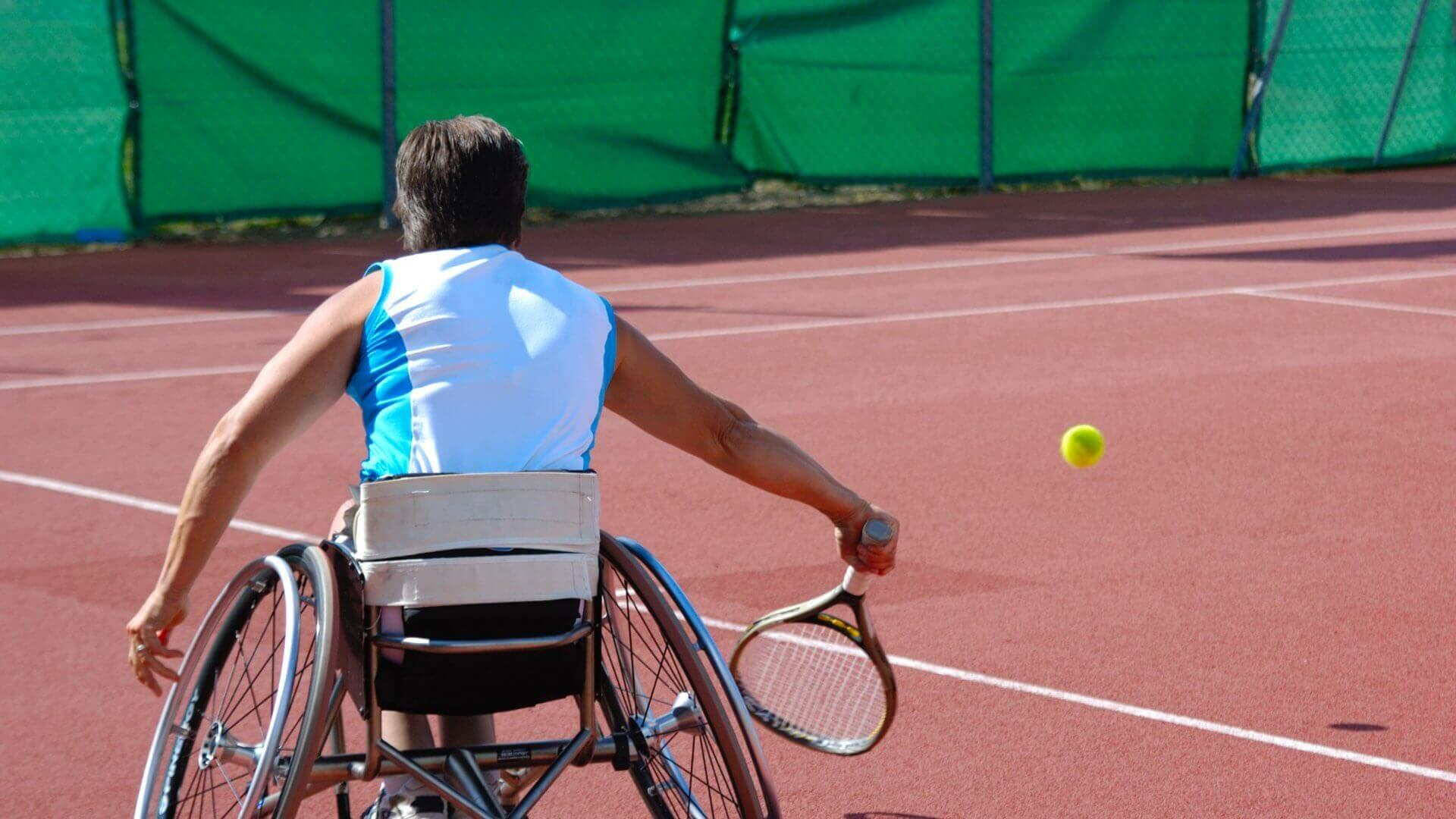 Person playing wheelchair tennis
