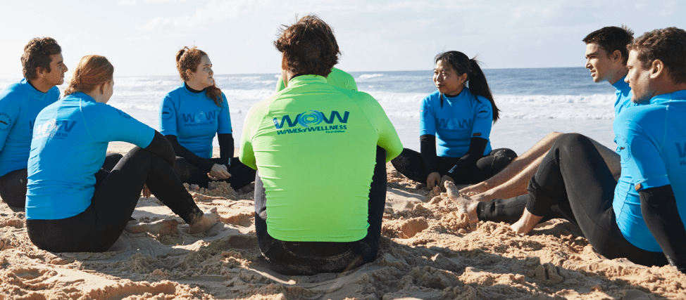 Waves of Wellness surfers