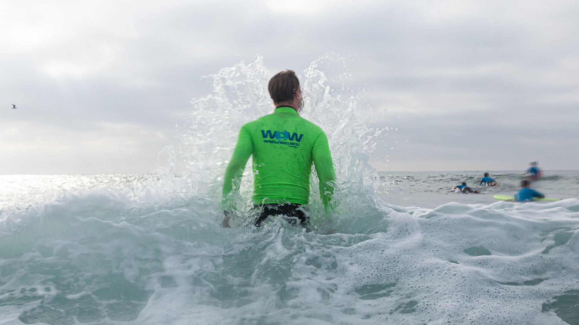 Waves of Wellness surfing